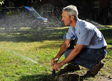 Tom, one of our Orlando irrigation repair contractors, is adjusting a sprinkler head